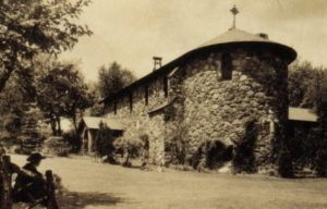 Chapel of St. Anne, ca. 1920. This view of the east end of the main chapel was made prior to the addition of the Chapel of the Holy Spirit to the south. Father Founder Frederick Cecil Powell looks on. Our October program.