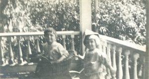 Nina Winn's Niece and Nephew play on the porch of their nearby home. Click on image to view in closer detail.