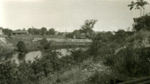 Looking northeast, 37 Summer St. is featured the distance at right, circa 1900. This scene nicely depicts the water and steeply banked landscape of Fowle's Mill Pond.