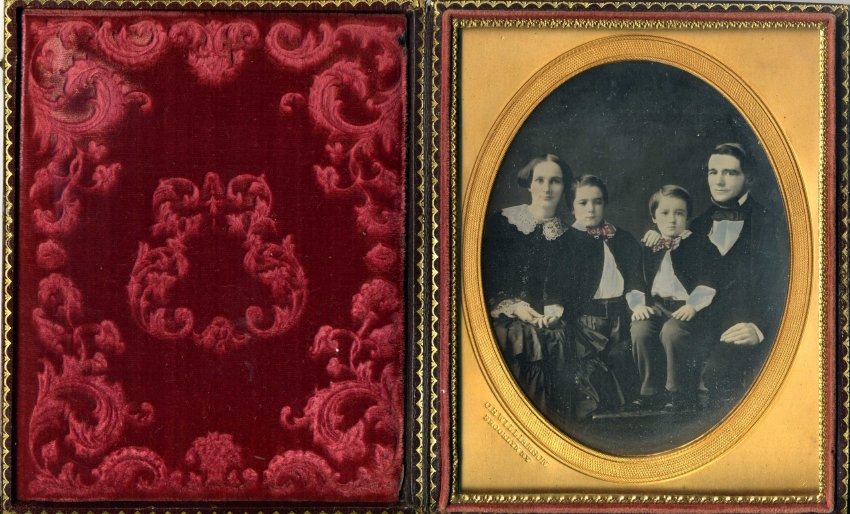 A circa 1853 daguerreotype image shows Maria Farmer, her husband Eli Robbins, and their two sons, both of whom died before reaching adulthood. Note the elaborate cushion of cut red velvet, intended to protect the glass-encased image.